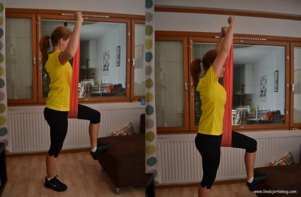 axelpress med gummiband - träning hemma