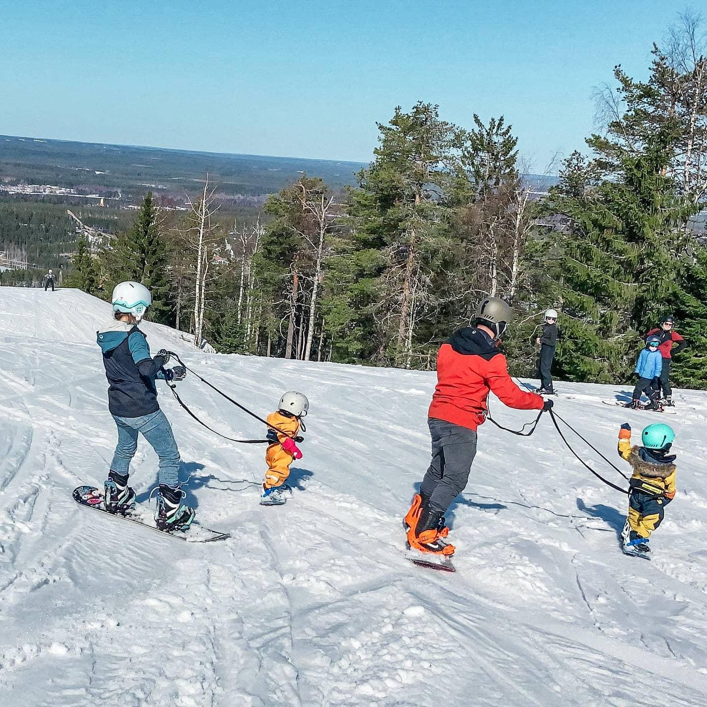 lära barn åka snowboard